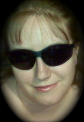 Me, in my crazy dark glasses...  and yes, I wear my sunglasses at night.