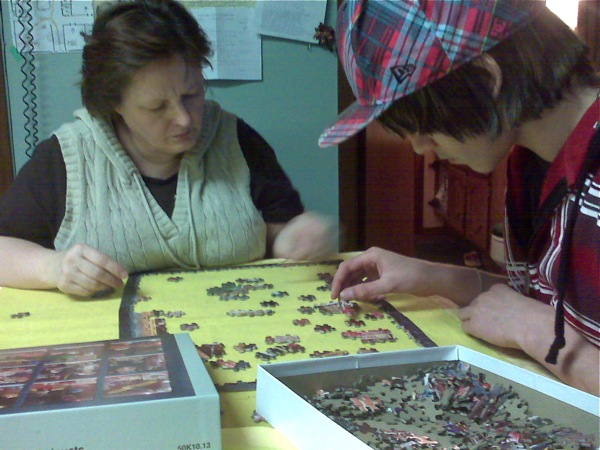 Mom and Aaron working on a jigsaw puzzle