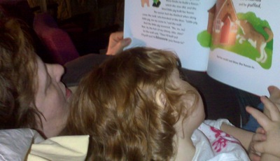 Lily-Ann and Grams, reading a book