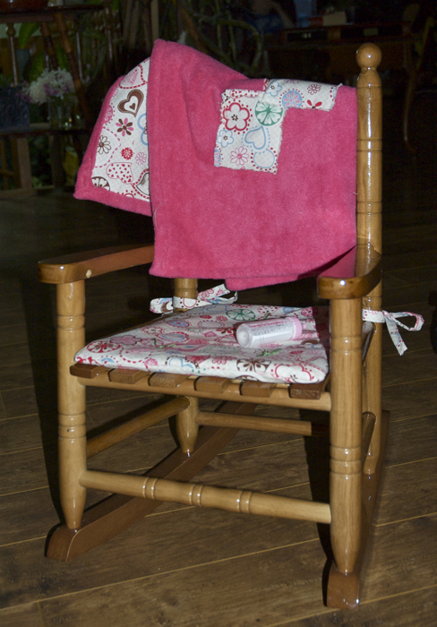 new rocking chair, with a mom-made cushion and lap blanket.