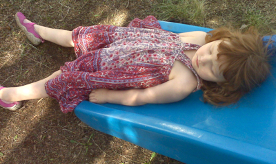 the wee girlie, napping on her slide