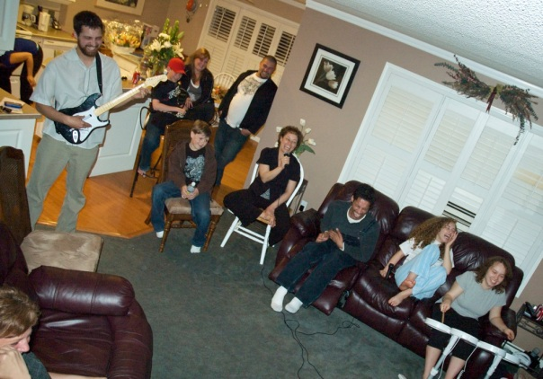 the whole family gathered around to play Rock Band