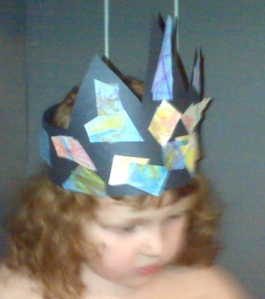wee girlie wearing a crown she made from construction paper