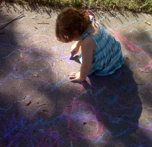 playing in a sidewalk-chalk-river