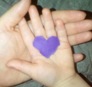 the wee girlie and I, holding a little purple paper heart