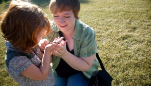 Tobi-Dawne Smith and her daughter, Lily-Ann, experiencing the joy of finding a baby snake out in the green of Saskatchewan.