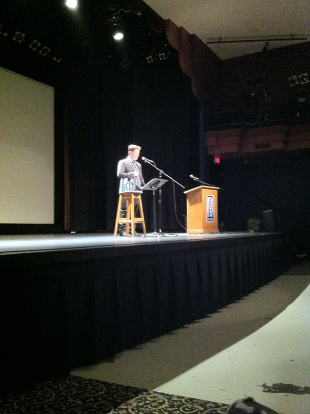 Ivan Coyote speaking at the Broadway Theatre in Saskatoon Saskatchewan