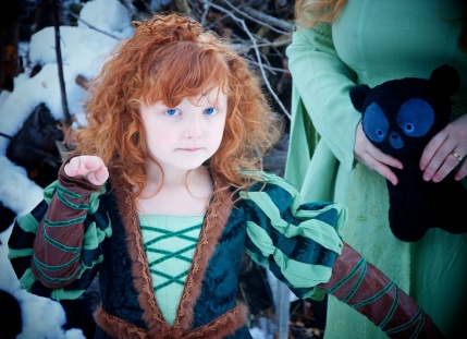Lily-Ann as Merida, a perfect fit with her naturally red curly hair.