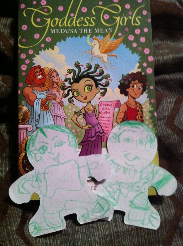 The cover art for Medusa the Mean, and the girl's interpretation of Medusa and Dionysus.