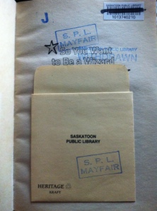 Inside my copy of So You Want to Be a Wizard, the withdrawn stamp and the kraft paper envelope... memories.