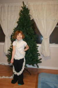Lily-Ann, all wrapped up in garlands, ready for Yule!