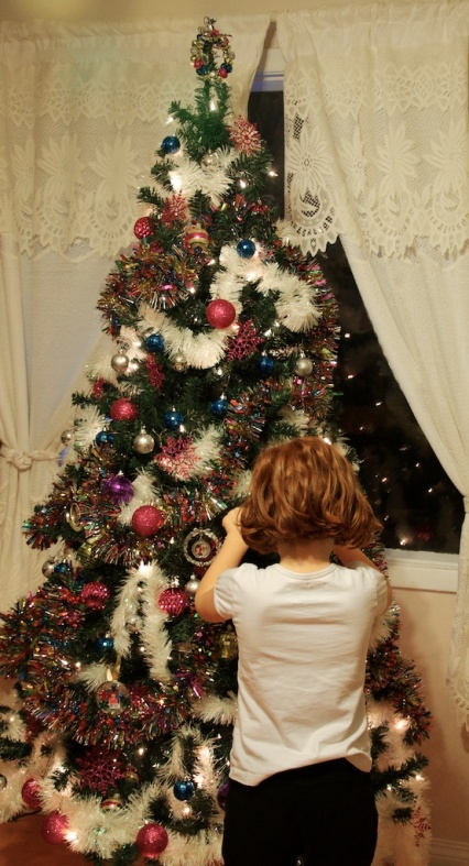Kid Kid decorating our Yule Tree, our first year with a large tree!