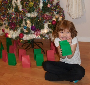 ready to open bag number one from her advent calendar.