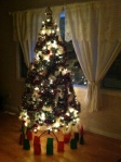our tree, all lit up in the dark