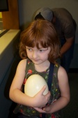 Checking out an Ostrich egg in Rafiki's wildlife center (where the many biologists and animal care specialists work).