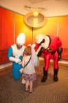 The girl couldn't believe that Mr. Incredible kissed her hand!
