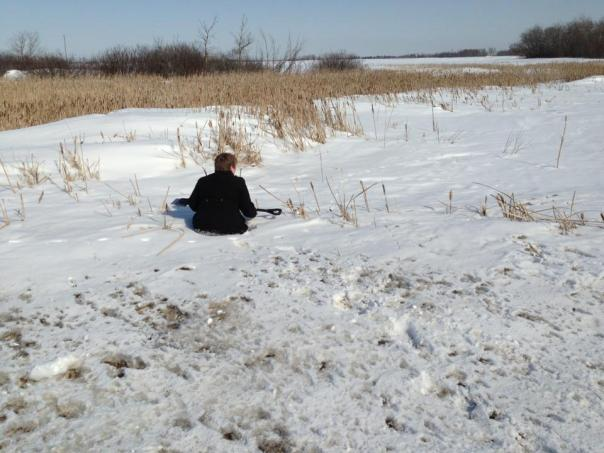 Hip deep, completely stuck, immobilized in the snow and ice.